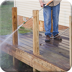 Man Pressure-washing the Deck